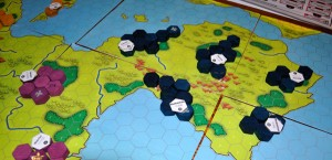 Players build around the fringes of their territory while trying not to get too close to other players for fear of attacks.
